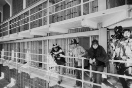 Part of a band of American Indians look over the main cell block of Alcatraz after occupying the island for the second time in two weeks in San Francisco on Nov. 19, 1969. The Indians say they want the island for a new Indian center to replace a San Francisco building destroyed by fire. The General Service Administration asked the Indians to leave but threatened no immediate action. (AP Photo/RWK)