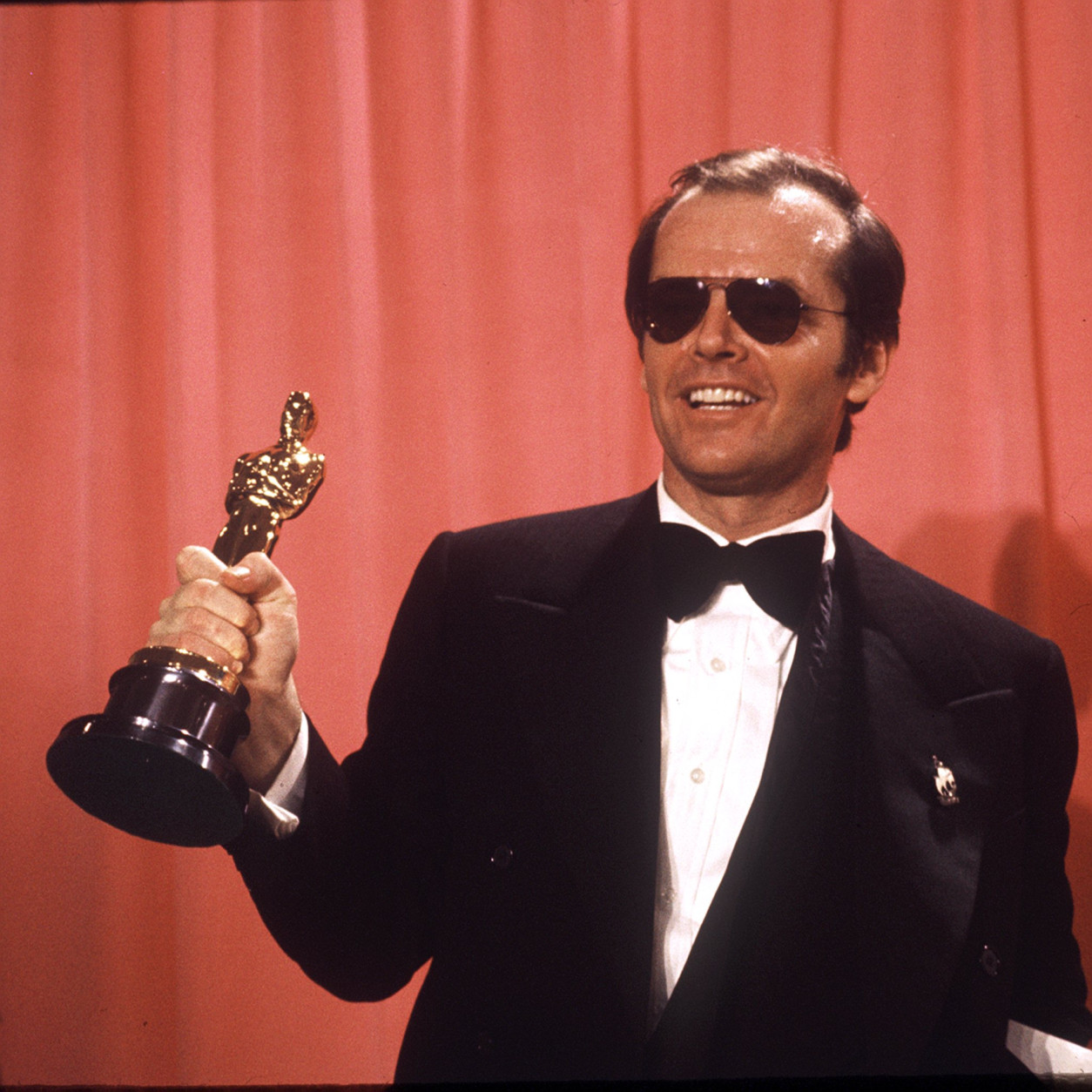 """Actor Jack Nicholson is 80 on April 22.  FILE - In this March 30, 1975 file photo, actor Jack Nicholson, named best actor of 1975 by the Motion Picture Academy, holds the Oscar he won for his role in """"One Flew over the Cuckoo's Nest"""" in Los Angeles.  Hundreds of artists, actors and musicians spent hours talking to Elliot Mintz, a radio and TV broadcaster in the 1960s and '70s, who is launching ElliotMintz.com on May 18, 2014.  Nicholson talked about the challenge of his """"One Flew Over the Cuckoo's Nest"""" role before he won the Oscar for it. (AP Photo, file)"""
