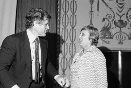 Sen. Edward Kennedy, D-Mass., left, chats with Gov. Ella T. Grasso, of Connecticut, prior to delivering the keynote address at the opening session of the Controlling Health Care Costs convention in Washington on Monday, June 27, 1977. Kennedy is chairman of the Senate Human Resources subcommittee on Health and Scientific Research. (AP Photo)