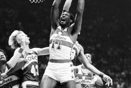 Washington Bullets Elvin Hayes leaps high to grap a rebound and later score early in the fifth game of the NBA World Championship on Friday, June 1, 1979 in Landover. Bullets Wes Unsold, 41, left, Seattle Sonics Jack Sikma, 43, and Bullets Tom Henderson, 14, get in one the action. (AP Photo)