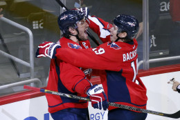 Washington Capitals left wing Alex Ovechkin, left, from Russia, celebrates his goal with center Nicklas Backstrom (19), from Sweden, during the third period of an NHL hockey game against the Dallas Stars, Thursday, Nov. 19, 2015, in Washington. Ovechkin scored his 484th career NHL goal, breaking Sergei Fedorov's record for most by a Russian-born player. The Stars won 3-2. (AP Photo/Alex Brandon)