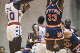 New York Knicks Patrick Ewing (33) goes up to block Washington Bullets Manute Bol's shot during an exhibition game at George Mason University in Fairfax, Va., Oct. 4, 1985. (AP Photo/Ron Edmonds)