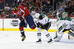 Washington Capitals left wing Alex Ovechkin (8), from Russia, is knocked from his skates by Dallas Stars defenseman Jyrki Jokipakka (2), from Finland, during the first period of an NHL hockey game, Thursday, Nov. 19, 2015, in Washington. (AP Photo/Alex Brandon)