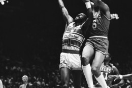 Gus Williams of the Washington Bullets goes up with a layup despite Julius Erving of the Philadelphia 76ers reaching up from behind. Action took place in the first quarter of their NBA Playoff game at the Capital Centre in Landover on Tuesday night, April 22, 1986. (AP Photo/Bill Smith)