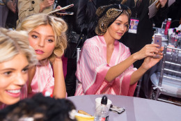 Gigi Hadid appears backstage in hair and makeup at the 2015 Victoria Secret Fashion Show at the Lexington Armory on Tuesday, Nov. 10, 2015, in New York. The Victoria's Secret Fashion Show will air on CBS on Tuesday, December 8th at 10pm EST. (Photo by Charles Sykes/Invision/AP)