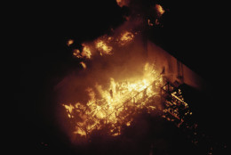 Structures in the back lot of Universal Studios burn in the Universal City section of Los Angeles on Nov. 6, 1990. (AP Photo/Reed Saxon)