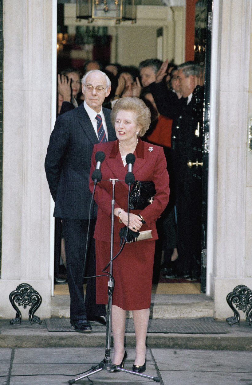 Margaret Thatcher and her husband Denis talks with reporters on the steps of No. 10 Downing Street, Westminster on Wednesday, Nov. 28, 1990 shortly before she made the short journey to Buckingham Palace to resign as Prime Minister to Queen Elizabeth. Thatcher, 65, stepped down after 11? years as leader John Major; her Chancellor of the Exchequer will take office following her resignation. (AP Photo/Martin Cleaver)