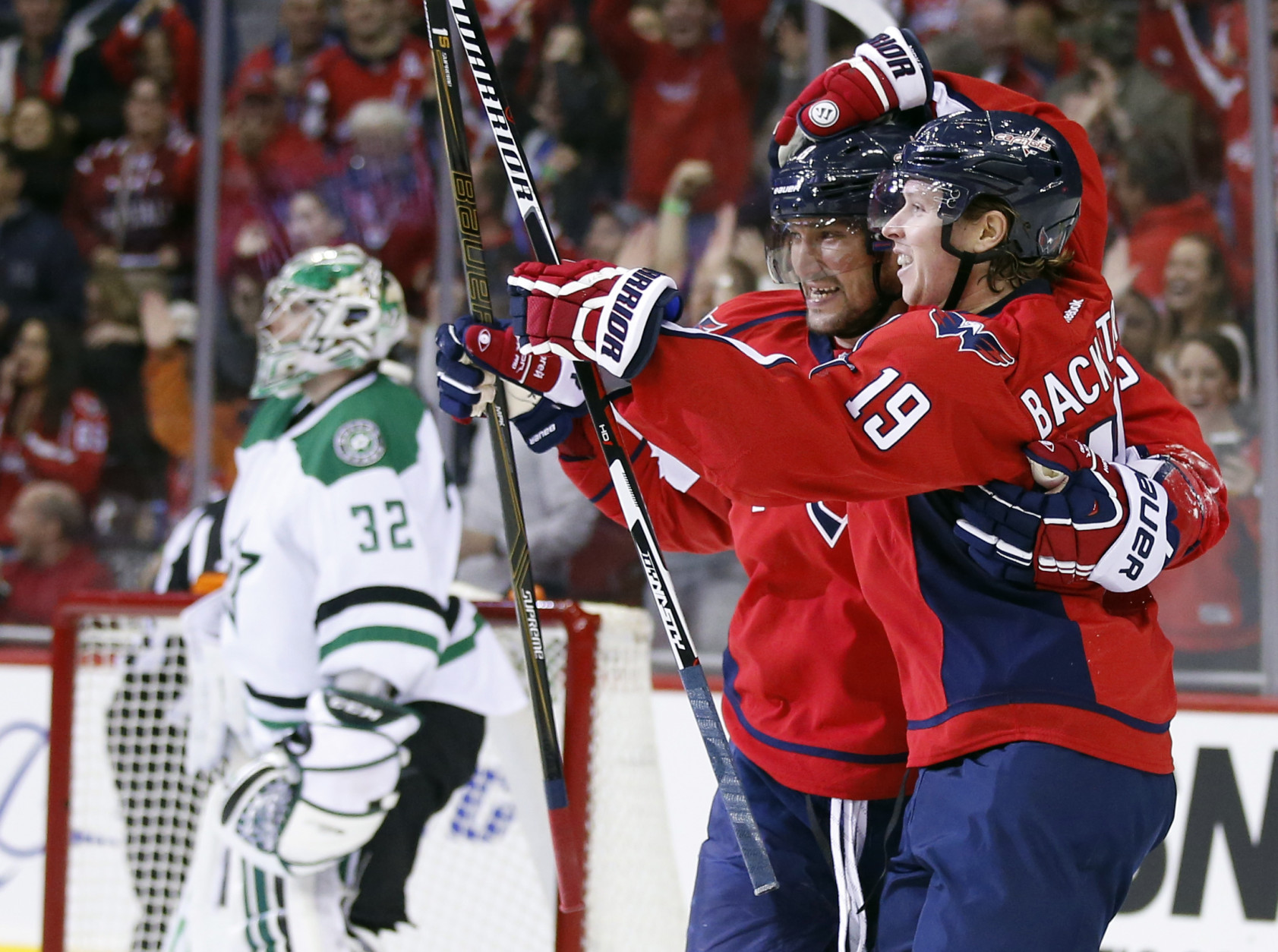 Washington Capitals left wing Alex Ovechkin (8), from Russia, celebrates with center Nicklas Backstrom (19), from Sweden, after Backstrom's goal past Dallas Stars goalie Kari Lehtonen (32), from Finland, during the first period of an NHL hockey game, Thursday, Nov. 19, 2015, in Washington. (AP Photo/Alex Brandon)