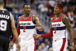 Washington Wizards guards John Wall (2) and Bradley Beal (3) react in the second half of an NBA basketball game against the San Antonio Spurs, Wednesday, Nov. 4, 2015, in Washington. The Wizards won 102-99.  (AP Photo/Alex Brandon)