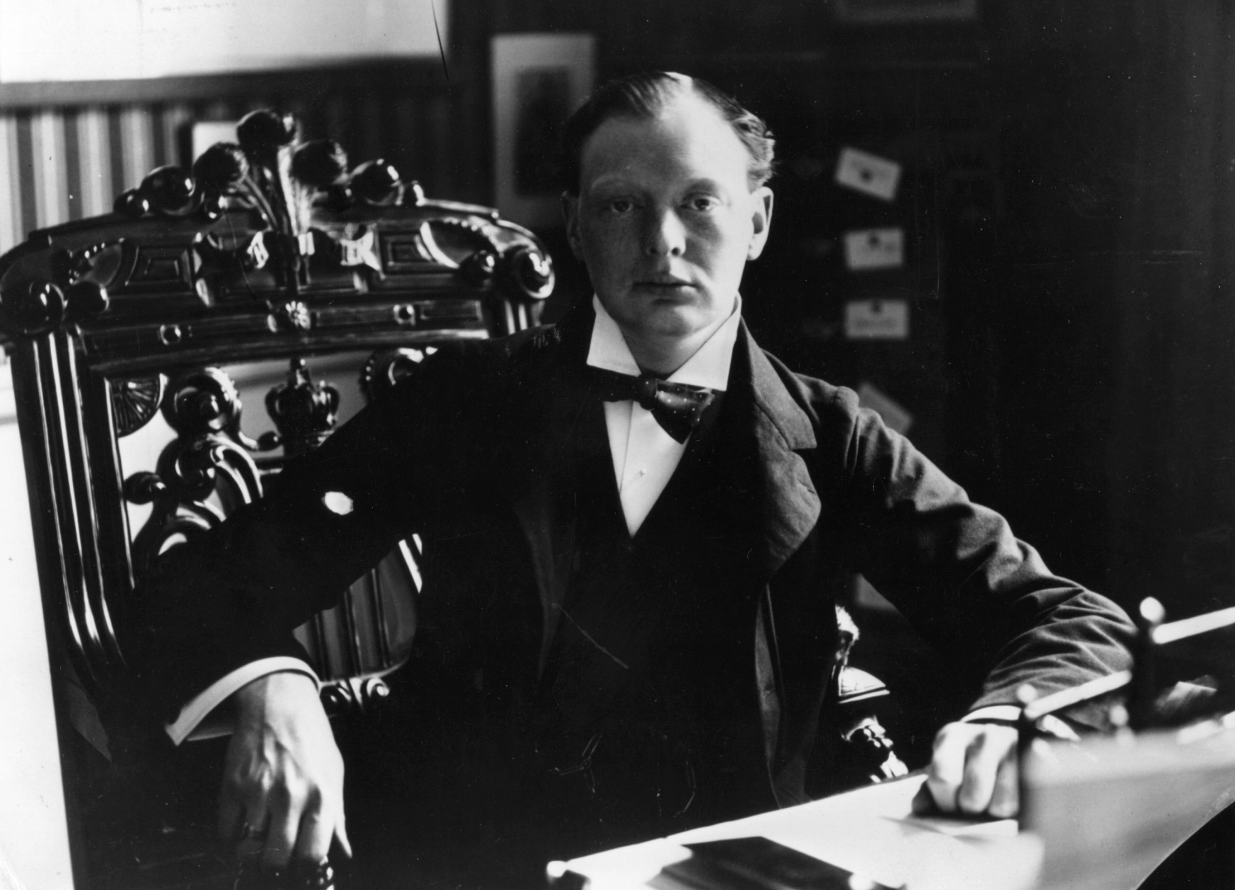 Winston Churchill (1874 - 1965), when MP for Oldham, seated at his desk.   (Photo by Rischgitz/Getty Images)