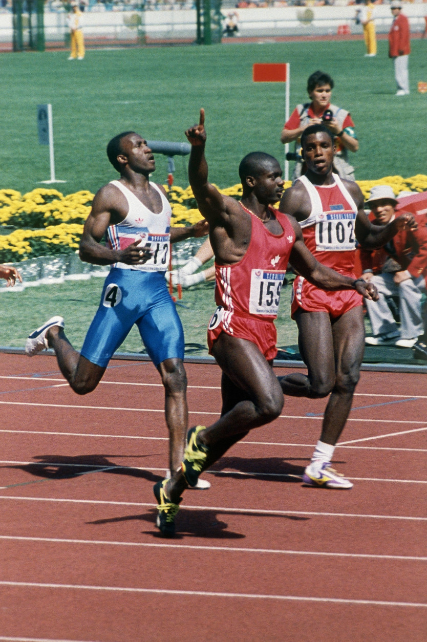 FILE - In this Sept. 24, 1988 file photo Ben Johnson of Canada gestures after winning the 100-meter dash beating Carl Lewis of the United States, behind at right at the Olympics in Seoul. The International Olympic Committee withdrew Johnson's gold medal for this event after he tested positive for steroids. (AP Photo/Fred Chartrand, file)