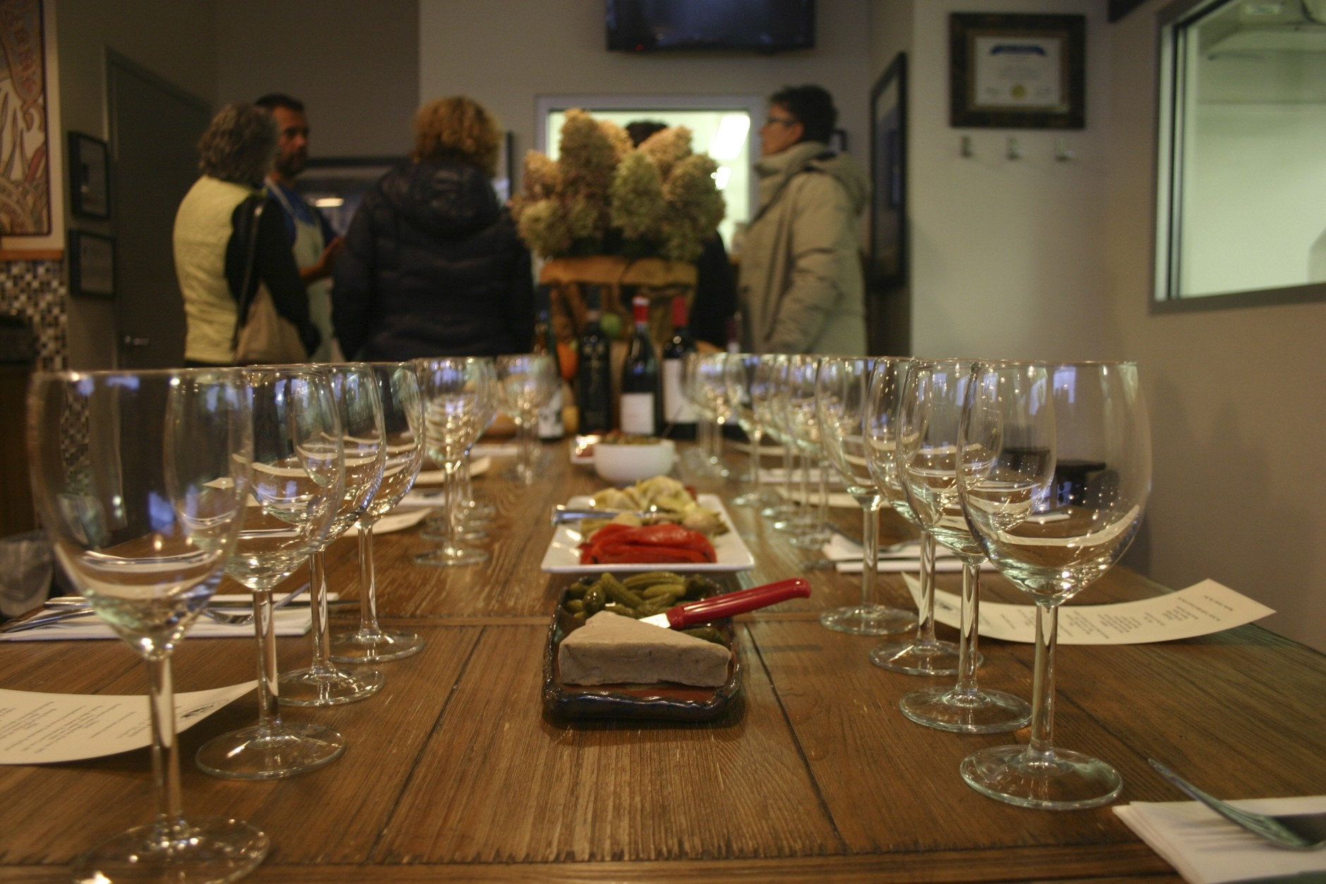 Soon, these visitors will sit down to a tasting and Pablo will walk them through the various cheeses and wines and suggest pairings for dining at home. (WTOP/Kate Ryan)
