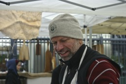 Mike Koch is now Executive Director of Fresh Farm Markets. The Dupont Circle farmer's market is year-round, so his Firefly Farms winter cap comes in handy.  (WTOP/Kate Ryan)