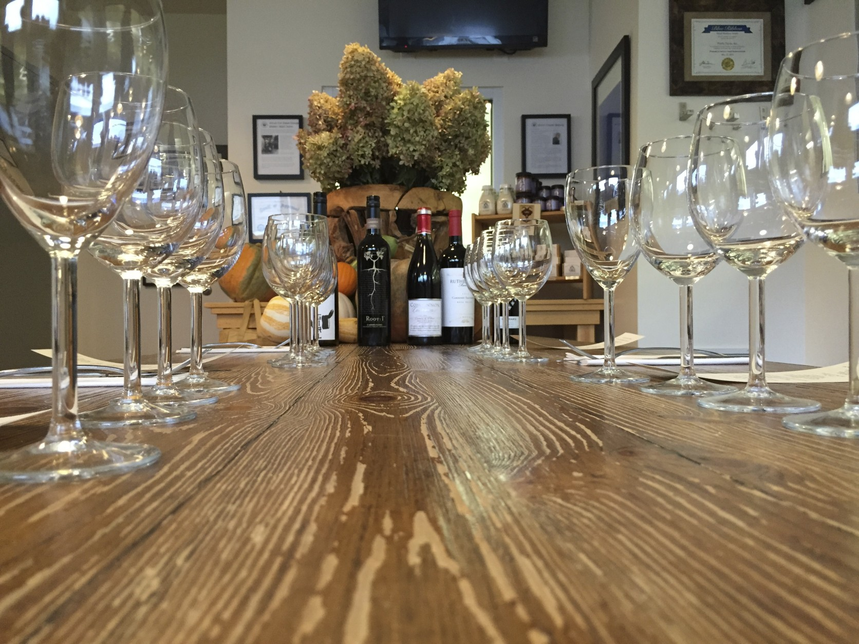 The table is set for a wine and cheese tasting at Firefly Farms Creamery. (WTOP/Kate Ryan)
