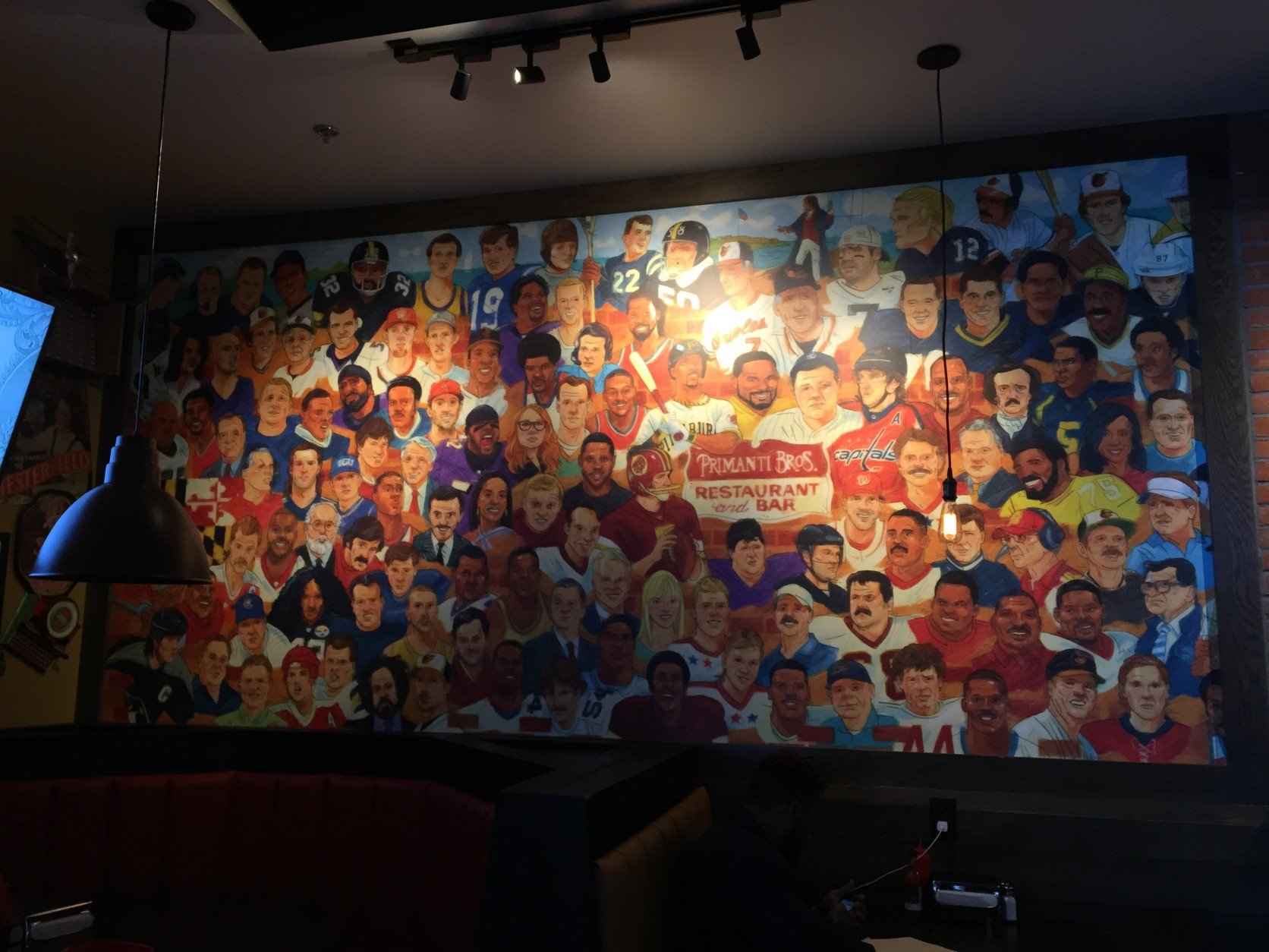 This mural at Primanti Bros. includes famous faces from Pittsburgh as well as the D.C. region. Who do you spot? (WTOP/Michelle Basch)