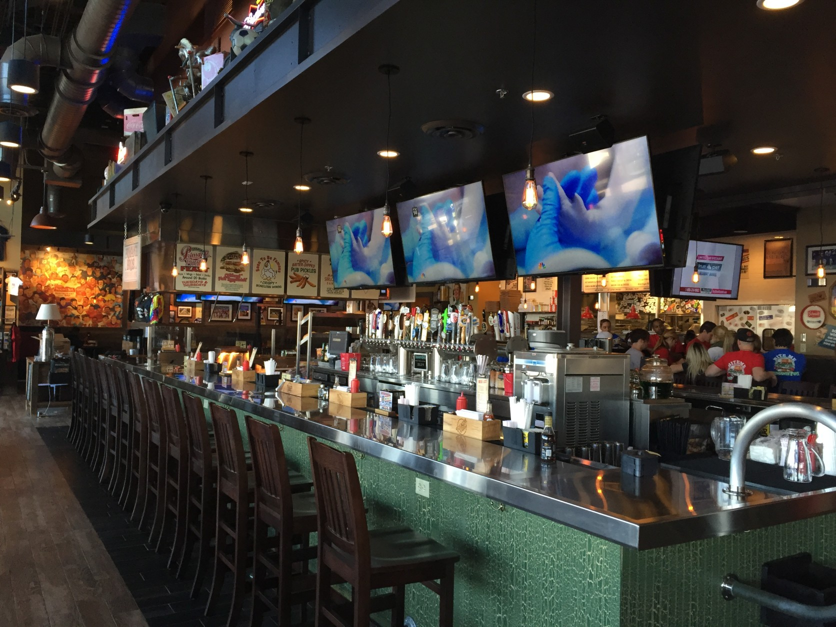The bar is stocked with plenty of beer on tap with an emphasis on craft brews. There's also a flat top grill at one end of the bar where you can watch your food order being filled. (WTOP/Michelle Basch)