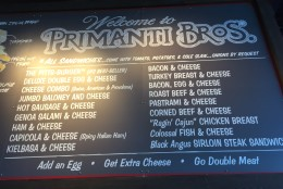 The sandwich menu at Primanti Bros. Each massive creation comes on thick Italian bread with fries, coleslaw, tomatoes and provolone cheese. (WTOP/Michelle Basch)