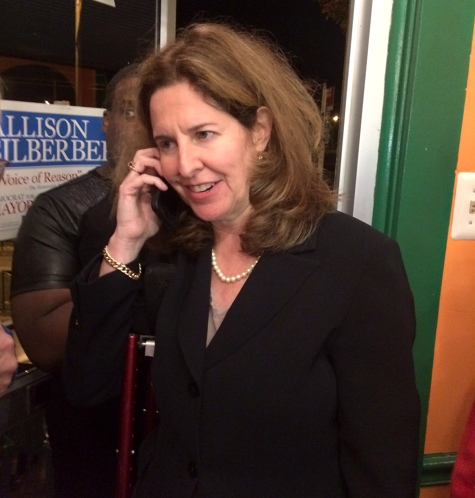 Alexandria Mayor-elect Allison Silberberg talks on the phone during her election night celebration in Del Ray on Tuesday, Nov. 3, 2015. (WTOP/Dick Uliano)