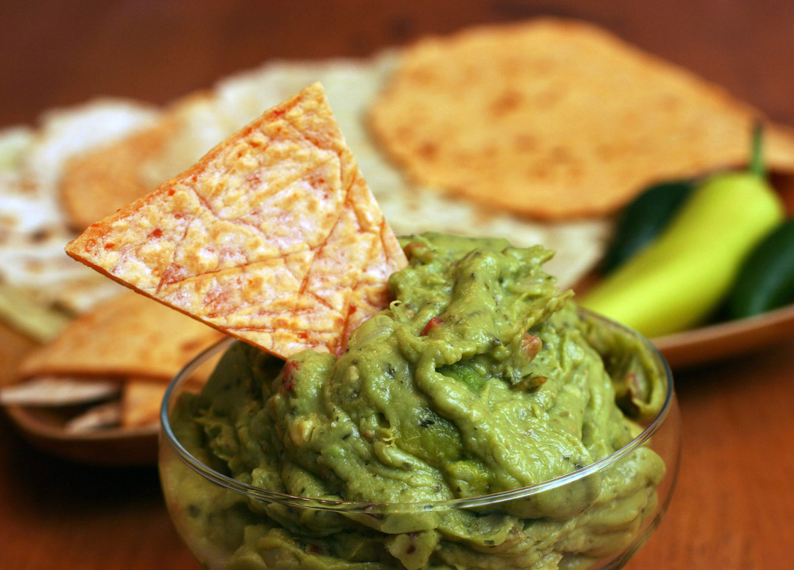 ** FOR USE WITH AP LIFESTYLES ** Homemade tortillas and guacamole are shown in this July 5, 2007 photo.  Homemade tortillas hot off the griddle taste great, are easy to make and can be tweaked to your particular tastes. (AP Photo/Larry Crowe)