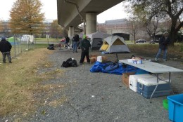 Some people in the 10 or so tents that remain want desperately to leave the encampment by the Watergate, but say housing promised to them isn't ready. (WTOP/Kristi King)