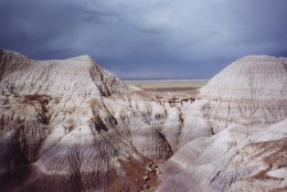 A storm rolls in over the Petrified Forest National Park in Arizona, Oct. 6, 2001, showing off the unique purplish-blue hills of the Blue Mesa trail. The 93,533-acre park is located in eastern Arizona, 25 miles north of Holbrook. (AP Photo/Alisa Blackwood)