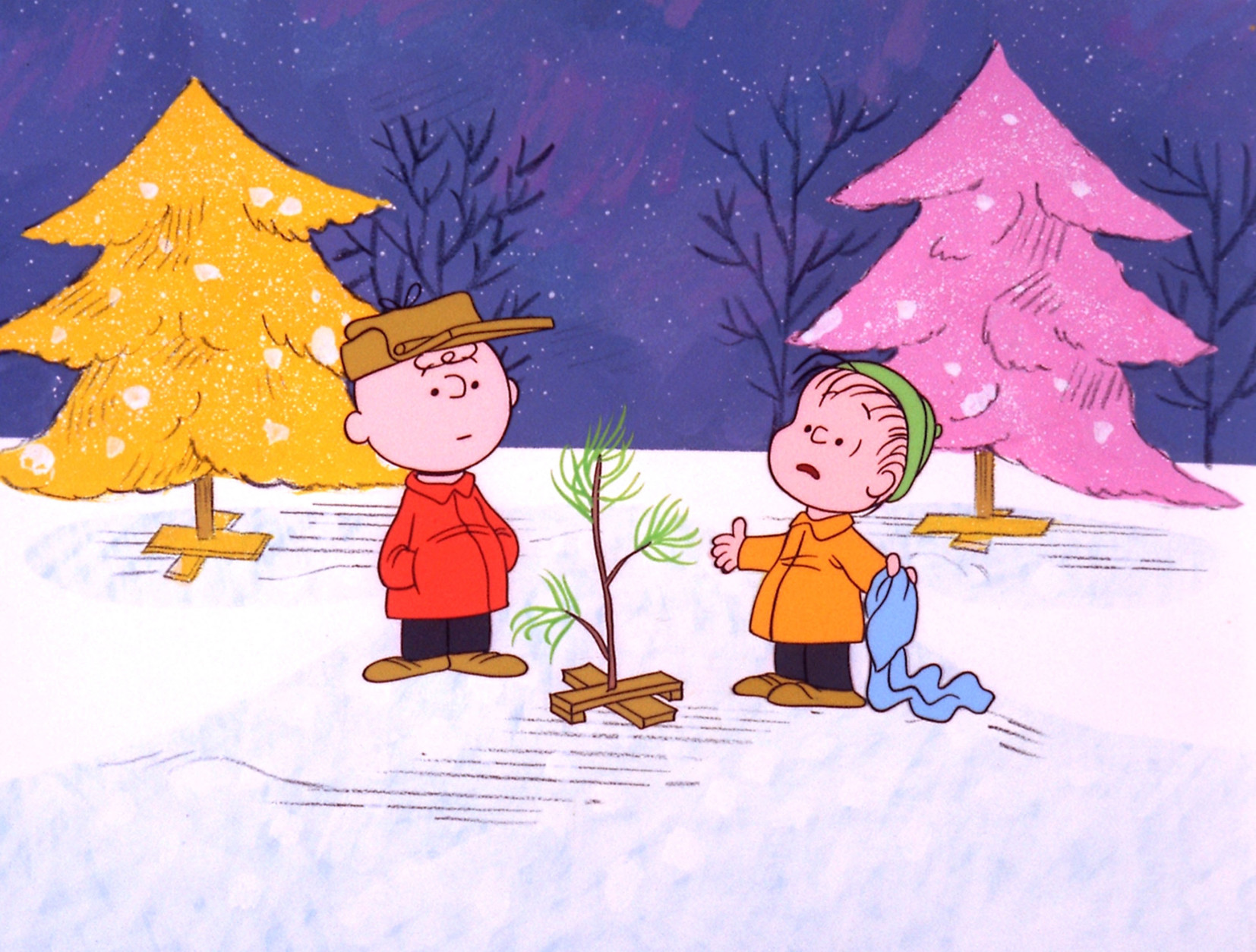 """In this promotional image provided by ABC TV, Charlie Brown and Linus appear in a scene from """"A Charlie Brown Christmas, which ABC will air Dec. 6 and Dec. 16 to commemorate the classic animated cartoon's 40th anniversary. The animated special was created by late cartoonist Charles M. Schulz in 1965. (AP Photo/ABC,  1965 United Feature Syndicate Inc.)"""
