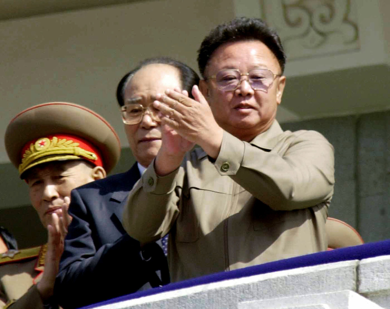 """FILE - In this April 25, 2002 file photo, North Korean leader Kim Jong Il, right, applauds with Kim Yong Nam, president of the People's Congress from the balcony of a building during a military parade, celebrating the 70th anniversary of the founding of North  Korean People's Army in Pyongyang, North Korea. North Korean television announced Monday, Dec. 19, 2011 in a """"special broadcast"""" that its leader Kim Jong Il has died in Pyongyang. (AP Photo/Katsumi Kasahara, File)"""