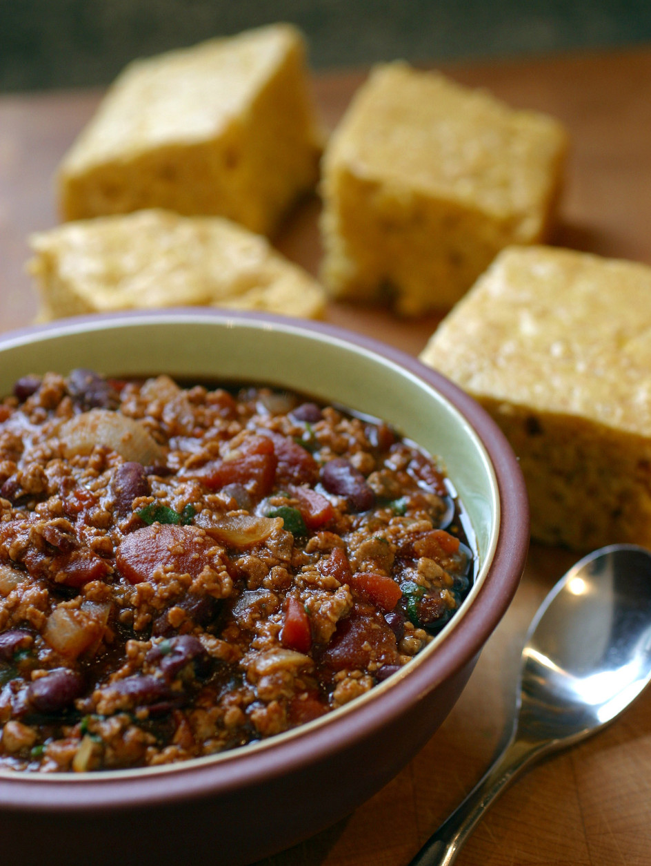 Corn Bread and Quick Chili are made in short order, for a weeknight meal than can be on the table in half an hour flat. Vegetarian chili is an easy, one-pot meal, and while most great chilies call for at least an hour of simmering, the absence of meat from this recipe speeds things along.  (AP Photo/Larry Crowe)