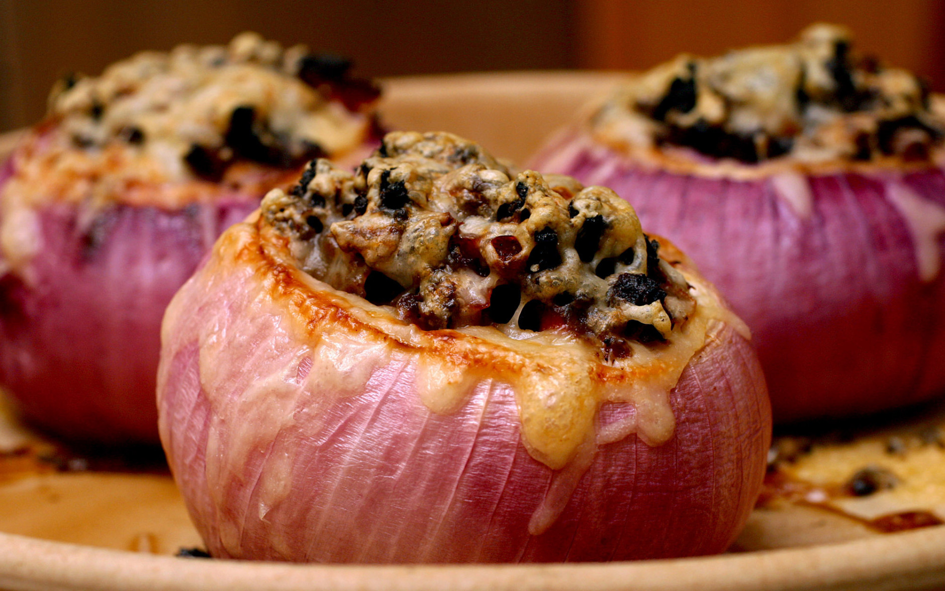 ** FOR USE WITH AP WEEKLY FEATURES **    Red Onion Chili is baked in hollowed-out onions. The sweetness of the onion complements the bold flavor of the vegetarian chili topped with cheese. (AP Photo/Larry Crowe)