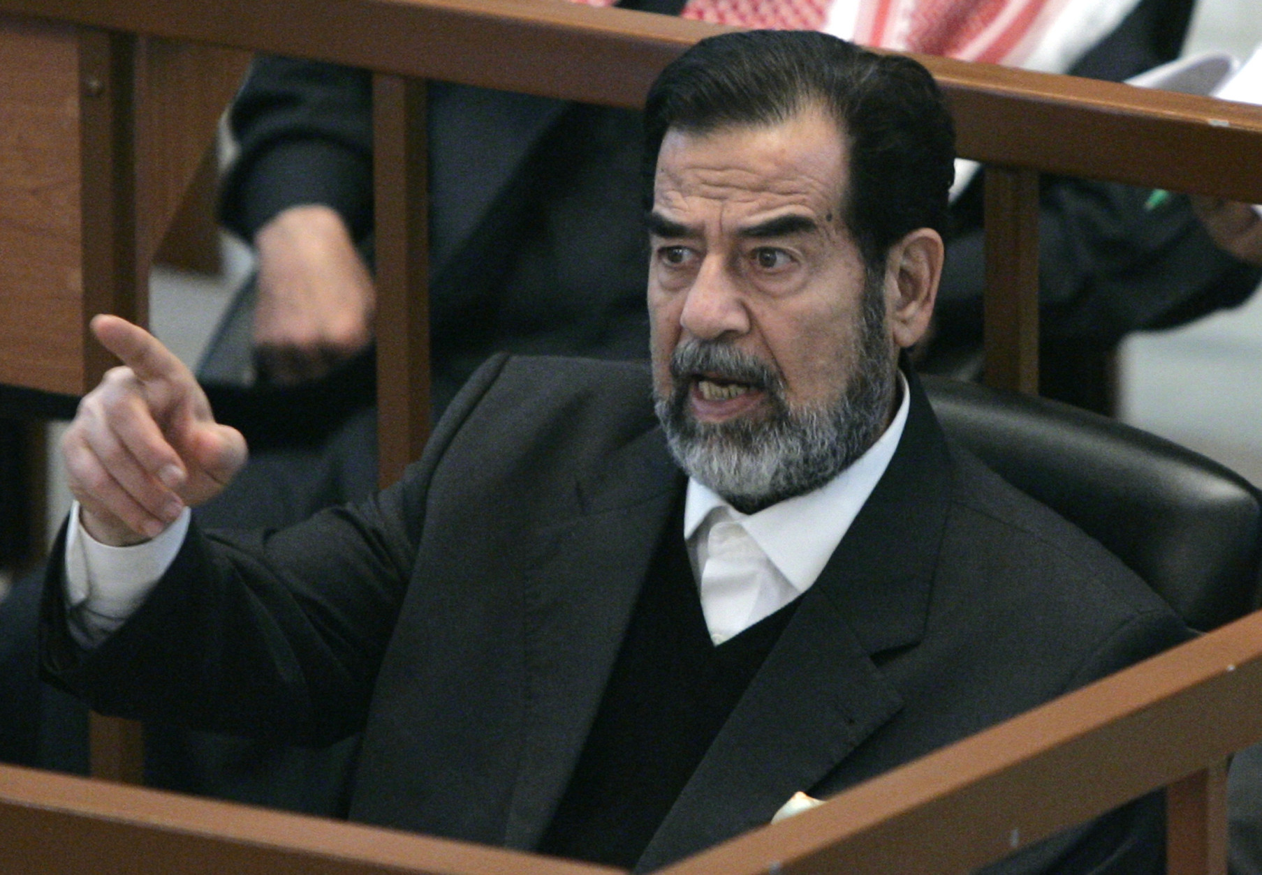 **FILE**  Former Iraqi President Saddam Hussein reacts in court while listening to the prosecution, during the Anfal genocide trial in Baghdad, Iraq, in this Dec. 21, 2006 file photo.  Some Arab media are reporting, Saturday morning, Dec. 30, 2006, that Saddam Hussein has been executed. The Associated Press is seeking confirmation. (AP Photo / Nikola Solic, pool, file)
