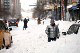 FILE- In this Dec. 27, 2010 file photo, people continue to dig out along 72nd Street in New York in the wake of a powerful East Coast blizzard that menaced would-be travelers by air, rail and highway, leaving thousands without a way to get home after the holidays and shutting down major airports and rail lines. The city has cleaned up from big storms before with ease, but this blizzard became unlike anything New Yorkers had seen in decades. (AP Photo/Craig Ruttle, File)