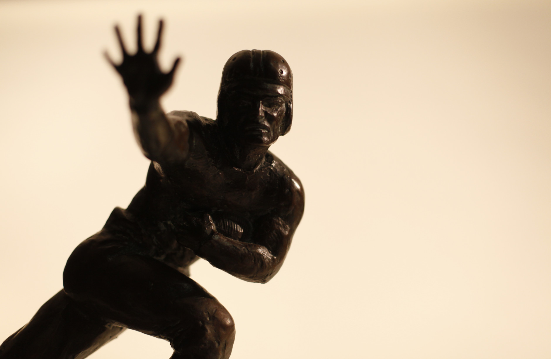 Pictured in this Friday, Nov. 18, 2011 photo in Chicago is the first 1935 Downtown Athletic Club trophy awarded to University of Chicago's Jay Berwanger. Following the death of John Heisman in 1936, who was the Director of Athletics at the Downtown Athletic Club, the award was renamed the Heisman Memorial Trophy. (AP Photo/Charles Rex Arbogast)