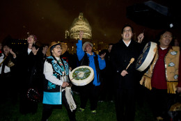 Amy Mitchell, second from left, and Adrea Ebona, front left, of the Tlingit tribe from Juneau, Alaska, and the Yaaw Tei Yi group, dance on the West Front of the Capitol in Washington, Wednesday, Dec. 2, 2015, during the lighting ceremony of the U.S. Capitol Christmas tree. The 2015 U.S. Capitol Christmas Tree is a 74 feet Lutz tree from Chugach National Forest in Alaska.   (AP Photo/Manuel Balce Ceneta)