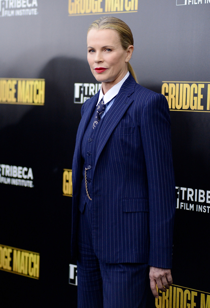 """Actress Kim Basinger attends the world premiere of """"Grudge Match"""", benefiting the Tribeca Film Institute, at the Ziegfeld Theatre on Monday, Dec. 16, 2013 in New York. (Photo by Evan Agostini/Invision/AP)"""