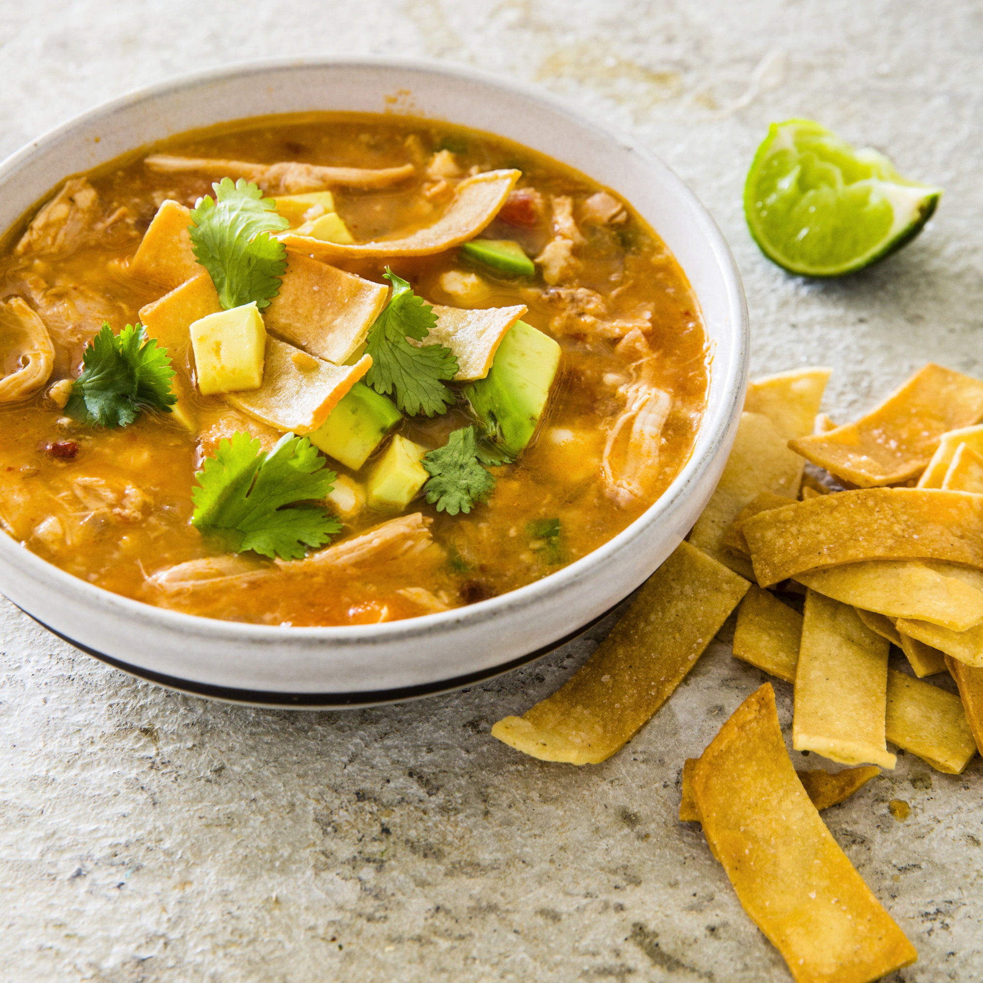"This undated photo provided by America's Test Kitchen in August 2018 shows a slow-cooker chicken tortilla soup in Brookline, Mass. This recipe appears in the cookbook ""Multicooker Perfection."" (Joe Keller/America's Test Kitchen via AP)"