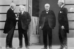 The Big Four of the Allies chat while gathering in Versailles for the Treaty of Versailles, which officially ended World War I, in this 1919 photo.  They are, left to right, David Lloyd George, of Great Britain, Vittorio Orlando, of Italy, Georges Clemenceau, of France, and Woodrow Wilson, United States President.  (AP Photo)