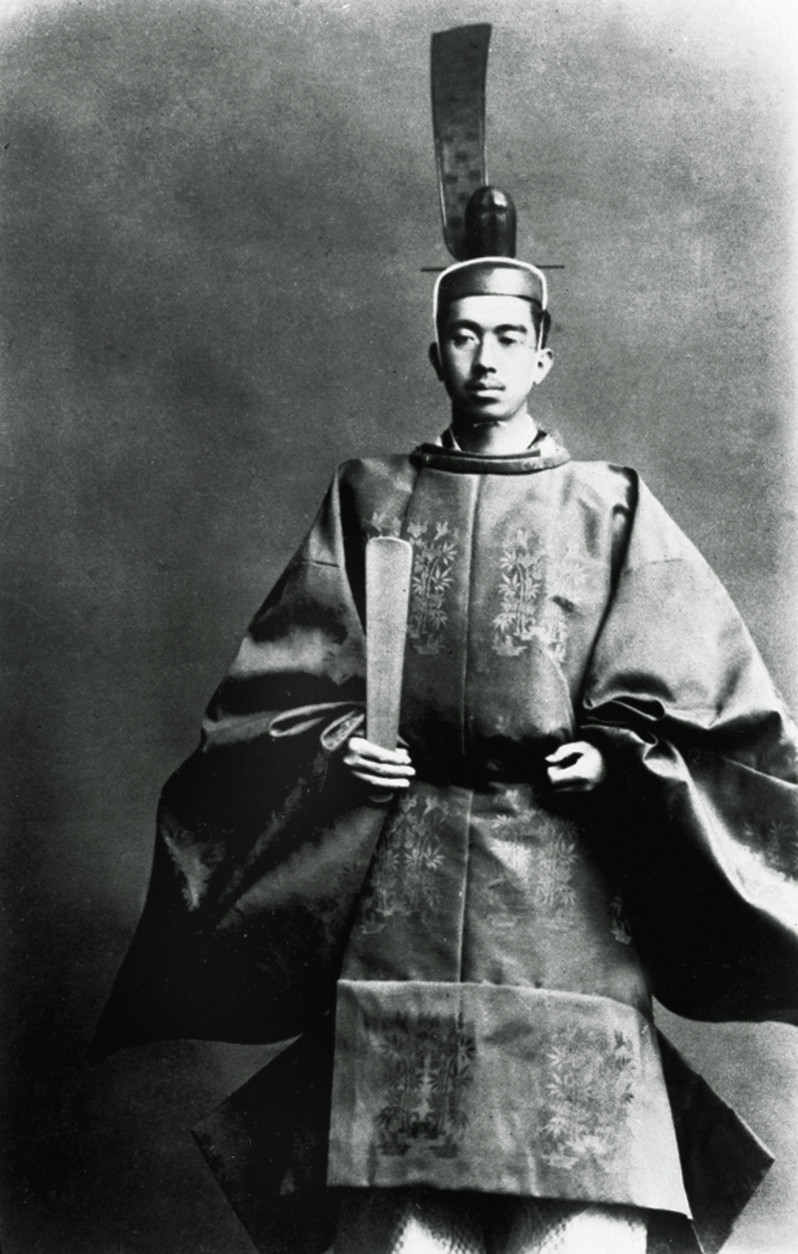 Emperor Hirohito poses in the imperial robes that he wore when he succeeded his father to Japan's throne in 1926, in Kyoto, Japan.  Hirohito's long reign included the years of World War II and Japan's surrender.  (AP Photo)