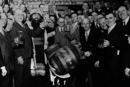 The Liederkranz Society Club in Milwaukee has a ceremony before the kegs got tapped to get beer flowing after it became legal again following the end of prohibition, April 6, 1933.  (AP Photo)