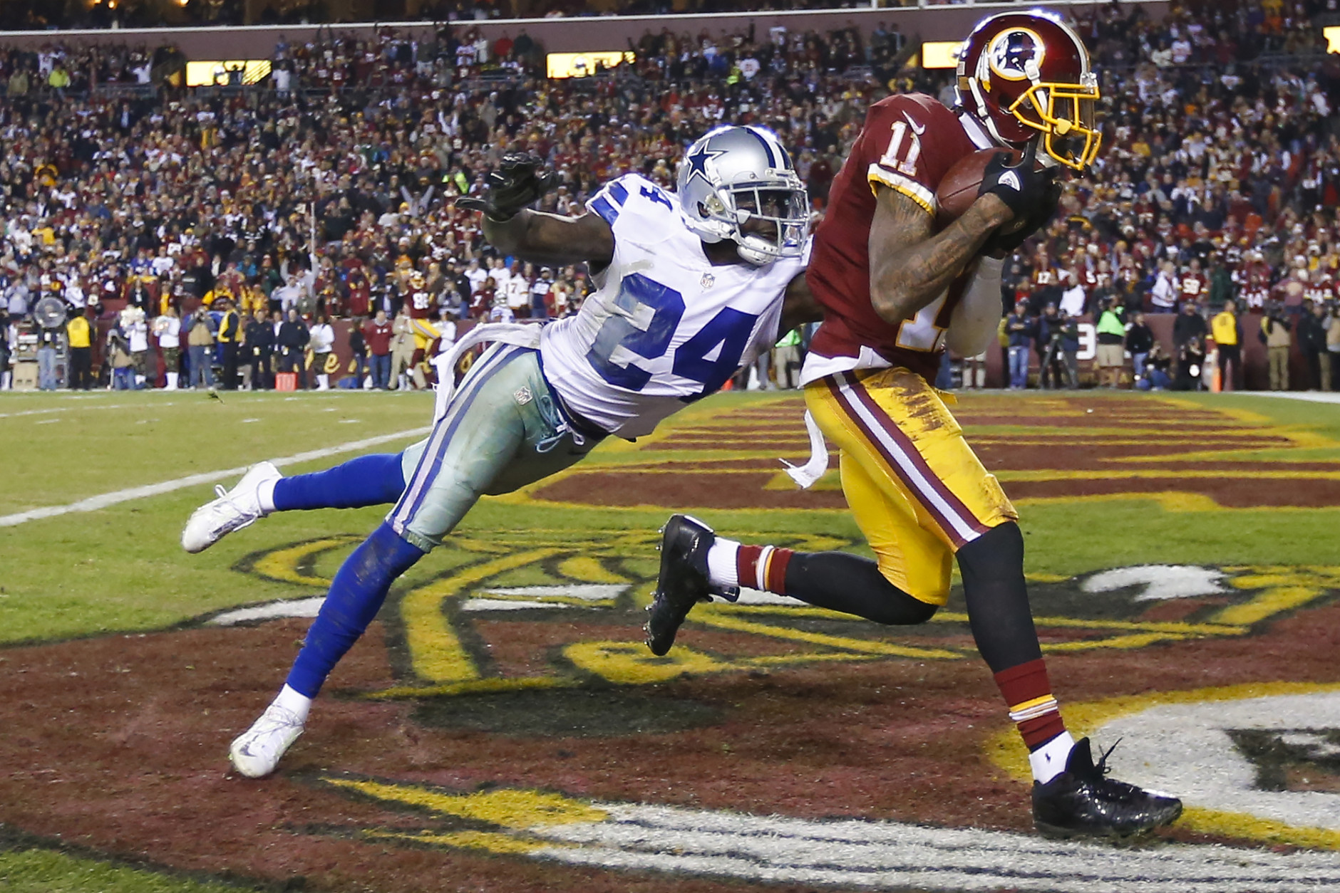 Washington Redskins wide receiver DeSean Jackson (11) pulls in a pass for a touchdown as Dallas Cowboys cornerback Morris Claiborne (24) reaches for him during the second half of an NFL football game in Landover, Md., Monday, Dec. 7, 2015. (AP Photo/Alex Brandon)