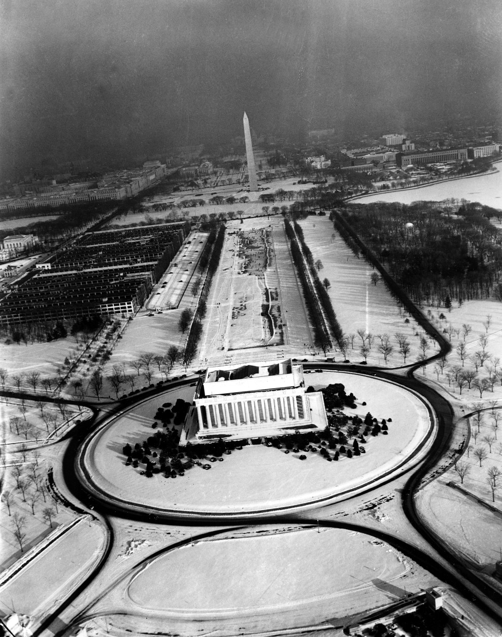 This aerial view of Washington, D.C., shows the Lincoln Memorial, center, with the Mall leading to the Washington Monument,  background, as snow covers the ground on Dec. 31, 1935.  (AP Photo)
