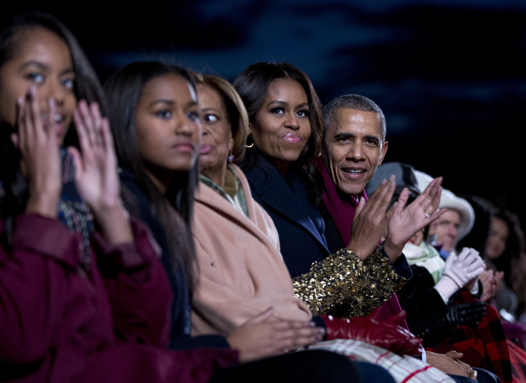 From right, President Barack Obama, first lady Michelle Obama, Michelle's mother Marian Robinson, daughters Sasha, and Malia, sit together during the National Christmas Tree Lighting ceremony at the Ellipse in Washington, Thursday, Dec. 3, 2015. (AP Photo/Carolyn Kaster)