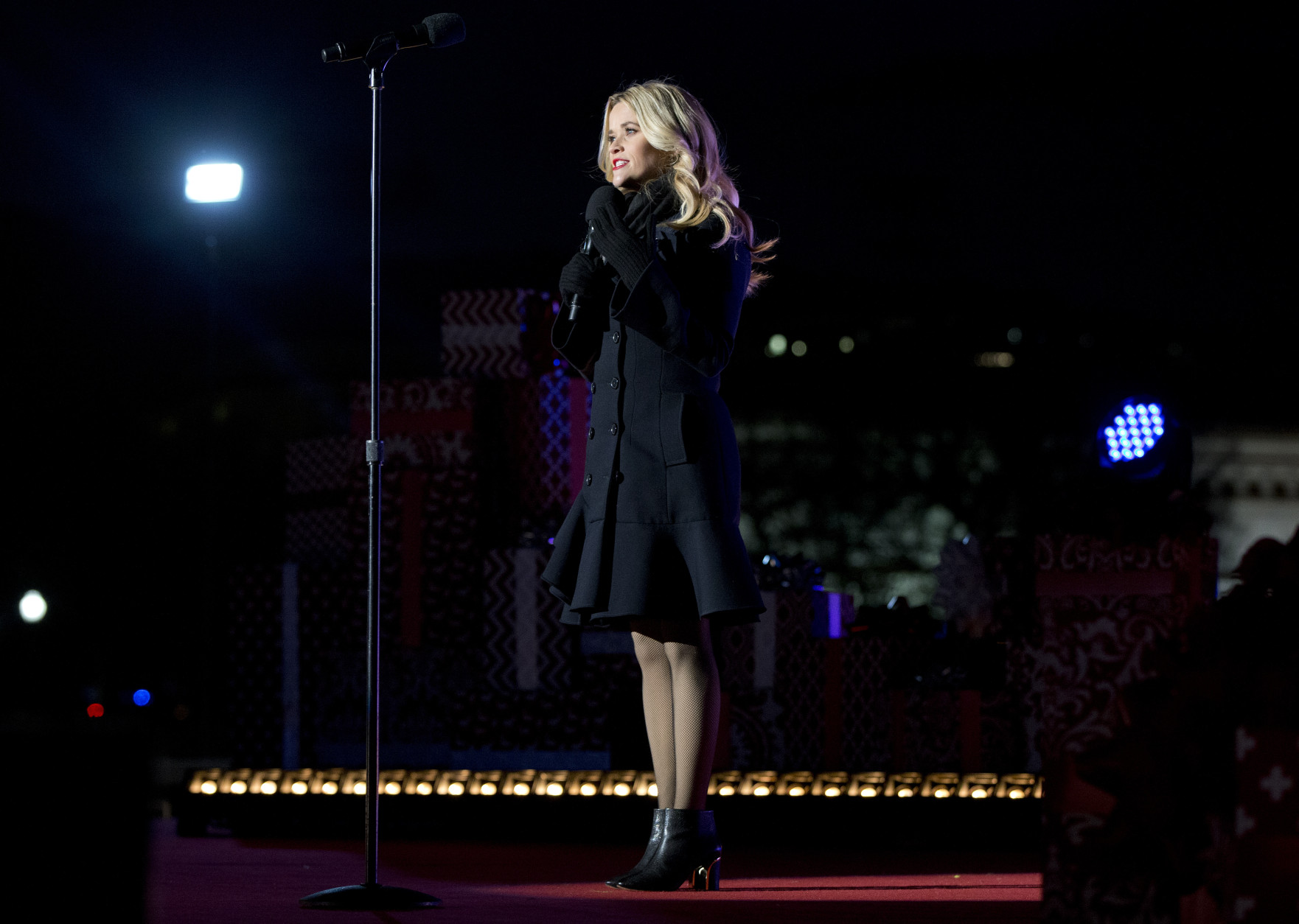 Reese Witherspoon speaks on stage during the National Christmas Tree Lighting ceremony at the Ellipse in Washington, Thursday, Dec. 3, 2015. (AP Photo/Carolyn Kaster)