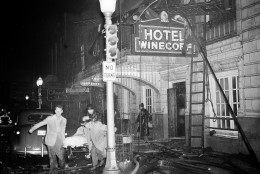 Rescue workers carry an unidentified victim from the still-blazing Winecoff Hotel in Atlanta, Ga., Dec. 7, 1946.  Officials estimate that over a hundred may be dead.  (AP Photo)