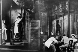 """The final scene of the original Broadway production of Tennessee Williams' play """" A Streetcar Named Desire,"""" is shown on December 17, 1947, in New York City. The cast includes Marlon Brando as Stanley Kowalski, Kim Hunter as Stella, and Jessica Tandy as Blanche. (AP Photo)"""