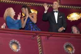 President Barack Obama waves as first lady Michelle Obama speaks to honoree singer-songwriter Carole King, left, as the Obama's arrive to the 2015 Kennedy Center Honors in Washington, after the president made an address to the nation, Sunday, Dec. 6, 2015. (AP Photo/Jacquelyn Martin)