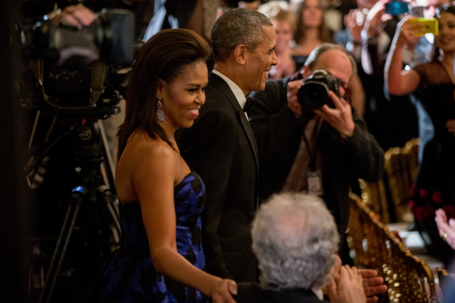President Barack Obama and first lady Michelle Obama arrive at the 2015 Kennedy Center Honors reception in the East Room of the White House, Sunday, Dec. 6, 2015, in Washington. The 2015 Kennedy Center Honors Honorees are singer-songwriter Carole King, filmmaker George Lucas, actress and singer Rita Moreno, conductor Seiji Ozawa, and actress Cicely Tyson. (AP Photo/Andrew Harnik)