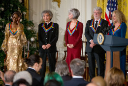 The 2015 Kennedy Center Honors Honorees, from left, actress Cicely Tyson, conductor Seiji Ozawa, actress and singer Rita Moreno, filmmaker George Lucas, and singer-songwriter Carole King stand on stage during a reception for them in the East Room of the White House, Sunday, Dec. 6, 2015, in Washington. (AP Photo/Andrew Harnik)