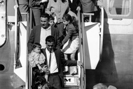 This is the first of 82 Cuban refugees to arrive from Varadero, Cuba to Miami, Fla., on Dec. 1, 1965.  (AP Photo)