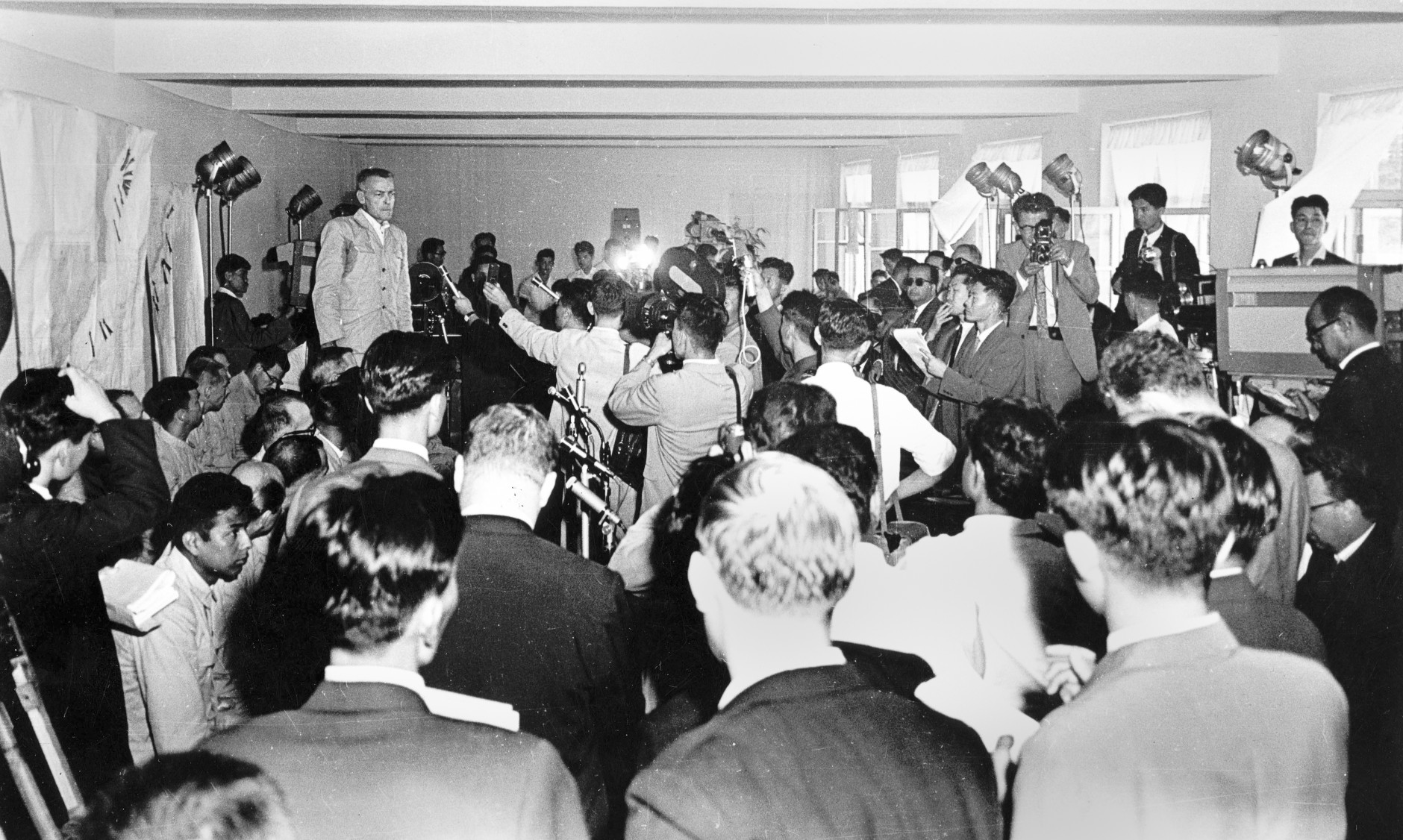 In this 1968 photo from North Korea's official Korean Central News Agency, distributed by Korea News Service, captain of the USS Pueblo, a Banner-class technical research ship (Navy intelligence), Commanding Officer Lloyd M. Bucher confesses his engagement in the spy operation. (Korean Central News Agency/Korea News Service via AP Images)