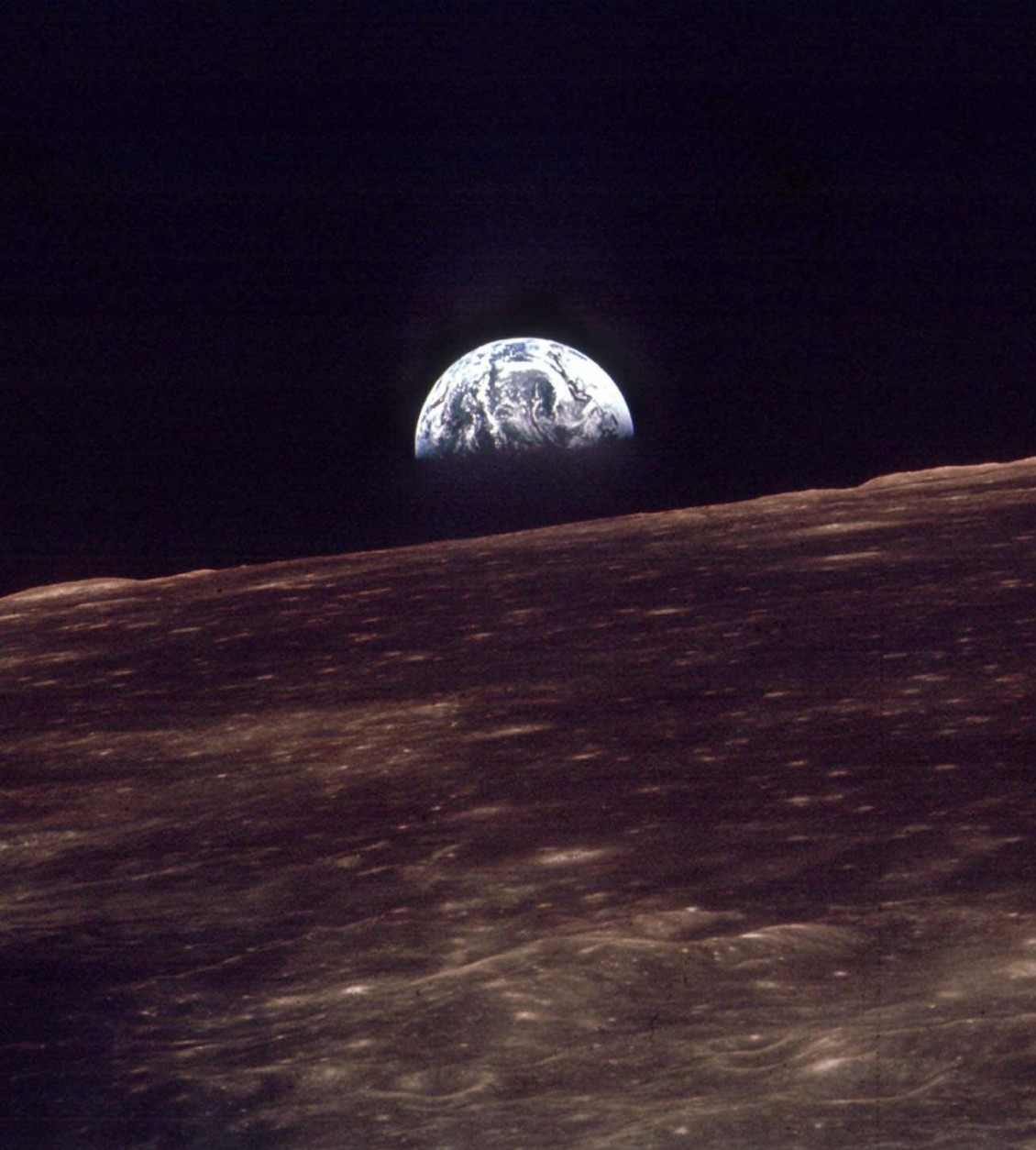 The Earth shines over the horizon of the Moon in this Dec. 24, 1968 photo shot by the astronauts on Apollo 8.  Apollo 8 was launched from Cape Canaveral on Dec. 21, 1968.  (AP Photo)